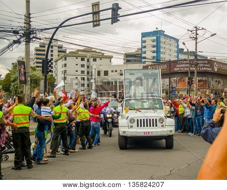 QUITO, ECUADOR - JULY 7, 2015: Ecuadorian people trying to touch and say welcome to pope Francisco, streets crowded.