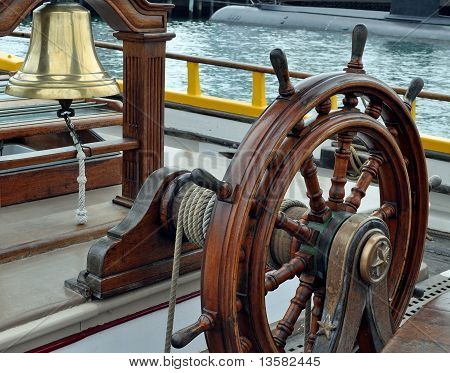 A Sailing Ship's Bell and Wheel