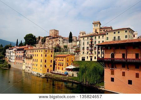 Bassano del Grappa, Italy - May 27, 2006: Handsome medieval town with its colourfully painted houses on the banks of the Brenta River