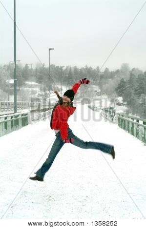 Young Girl Jumping Happy,Winter