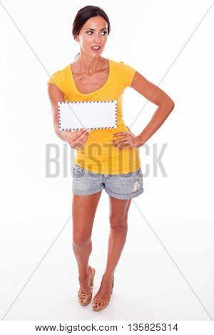 Wondering Young Brunette With Blank Envelope