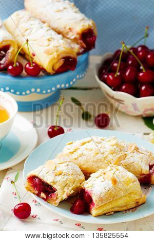 Pies from puff pastry with cherry. style vintage. selective focus