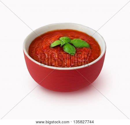 Tomato sauce with basil isolated on white background