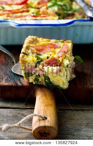 quiche with green onions and ham. style rustic. selective focus