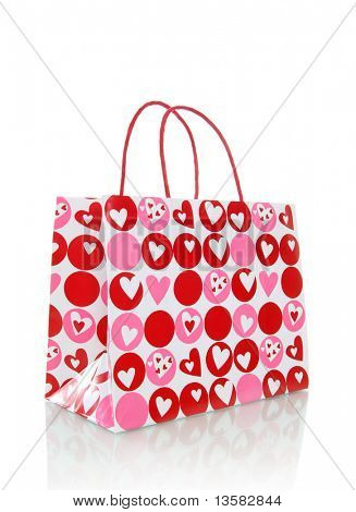A Valentines Day holiday bad with hearts over white background