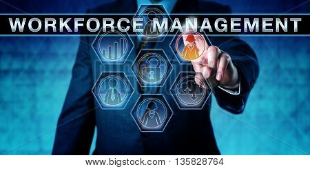 Businessman is pressing WORKFORCE MANAGEMENT on an interactive touch screen monitor. Human resource management metaphor and business software concept the development of a productive workforce.