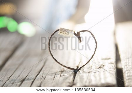 Love inscription and heart on vintage old wooden table