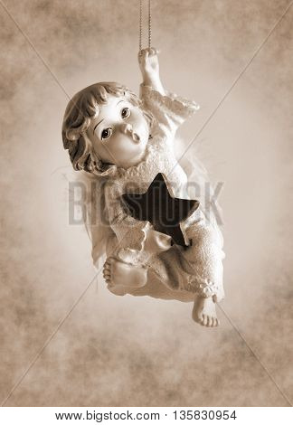 Statuette Little angel coming down from heaven - Sepia toned artwork in retro style