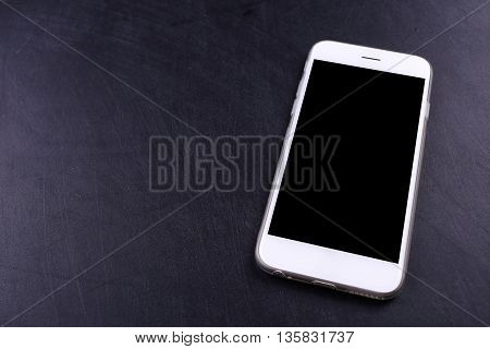 blank screen smartphon on black color wooden