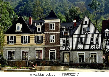 Bai Lu China - October 18 2012: Handsome French-inspired half-timbered and stucco houses line a village square *