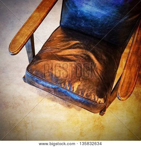 Retro style leather armchair. Image with grungy texture.