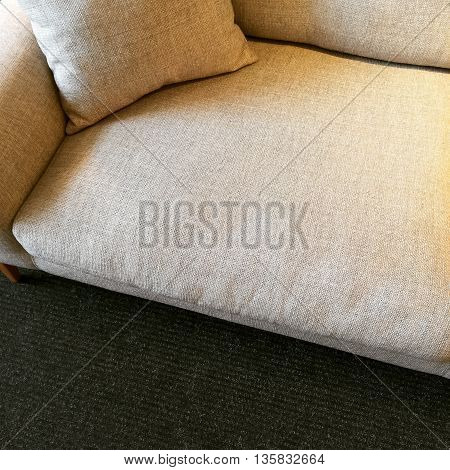 Simple beige sofa with cushion. Modern style furniture.