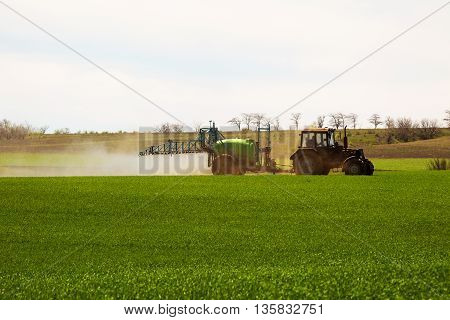 Odessa, Ukraine - April 17, 2016: Shot Of The Employee Performing Maintenance On The Green Field. Ap