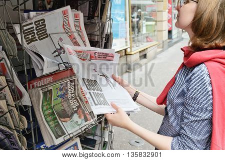 Woman Buying Liberation Newspaper With Shocking Headline About Brexit