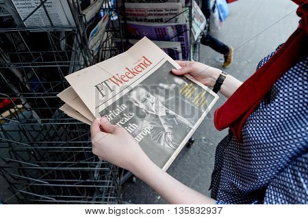Woman Buying Ft Weekend Newspaper With Shocking Headline About Brexit