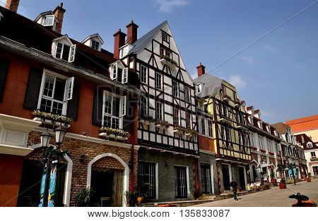 Bai Lu China - October 18 2012: View along La Grande Rue with its charming European-French style buildings featuring turrets towers and half-timbered houses