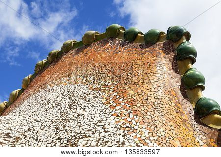 BARCELONA SPAIN - MAY 11 2016 : Casa Batllo housetop details with ceramic mosaic. Building redesigned in 1904 by Gaudi located in the center of Barcelona it is on the UNESCO World Heritage Site.