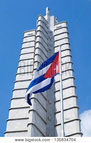 HAVANA,CUBA - JUNE 22,2016 : Monument and waving cuban flag at the Revolution Square in Havana