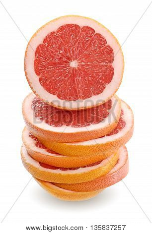 Close up Grapefruit sliced and stacked on white