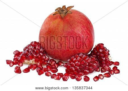Juicy pomegranate and pomegranate seeds on white