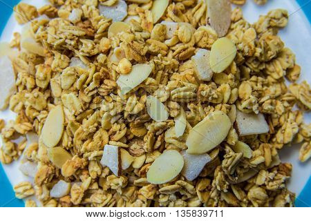 bowl of muesli with oats and sliced nuts