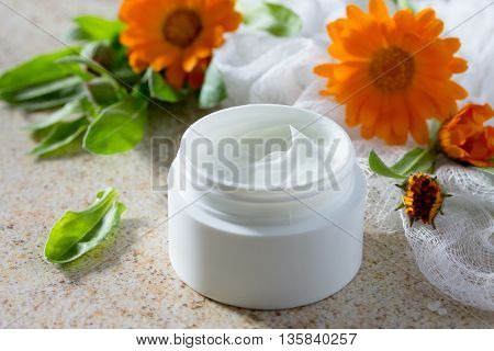 Face Cream Marigold On Brown Stone Background - Beauty Salon.