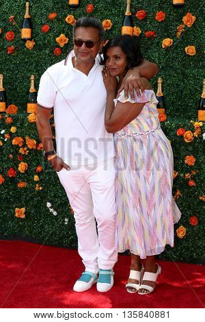 JERSEY CITY, NJ-MAY 30: Actress Mindy Kaling (R) and designer Naeem Khan attend the 8th Annual Veuve Clicquot Polo Classic at Liberty State Park on May 30, 2015 in Jersey City, NJ.