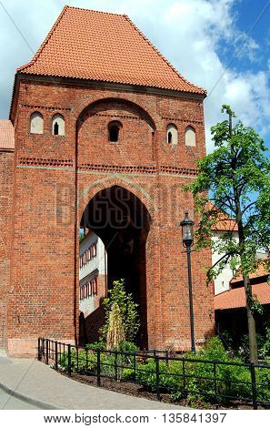 Torun Poland - May 25  2010: 13th century brick Gdanisko Tower one of the former medieval gateways into the city