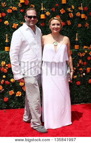 JERSEY CITY, NJ - MAY 30: John Duber (L) and Anastacia Stathakis attend the 8th Annual Veuve Clicquot Polo Classic at Liberty State Park on May 30, 2015 in Jersey  City, New Jersey.