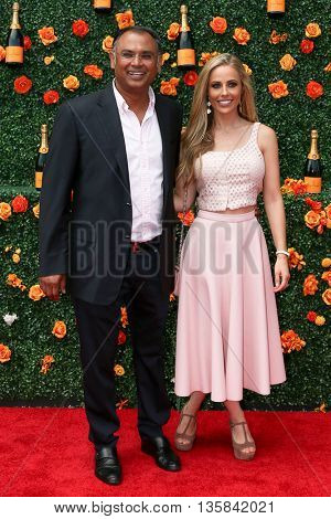 JERSEY CITY, NJ - MAY 30: Bash Kazi (L) and Crystal Martin attend the 8th Annual Veuve Clicquot Polo Classic at Liberty State Park on May 30, 2015 in Jersey  City, New Jersey.