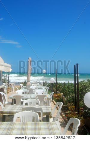 Picture of a romantic restaurant on the beach swept by the Mistral in Apulia - Italy