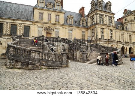 FONTAINEBLEAU, FRANCE - MAY 16, 2015: It is a symbol of Fontainebleau castle - the famous staircase in the shape of a horseshoe.