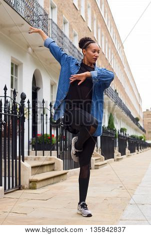 a young woman dancing in the street