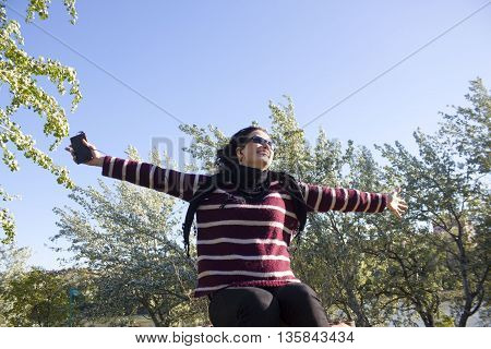 Woman Very Happy In A Park Listening To Music