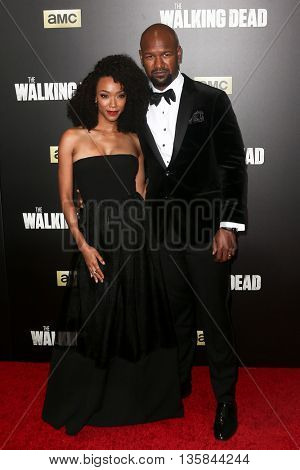 NEW YORK-OCT 9: Actress Sonequa Martin-Green (L) and Kenric Green attend AMC's 'The Walking Dead' season six premiere at Madison Square Garden on October 9, 2015 in New York City.