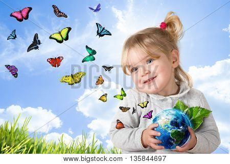 environment concept, child holding world with flying butterflies