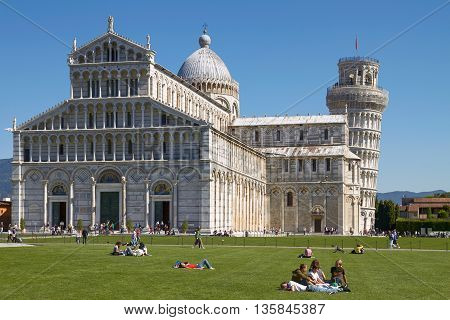 Pisa, Italy - September 29, 2010: Tourists Enjoying Sunny Day In Front Of The Leaning Tower Of Pisa