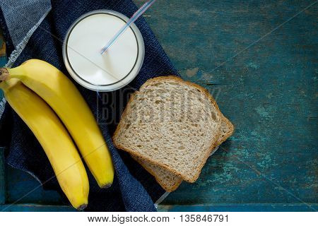 Cooked Breakfast With Toast Bread, Chocolate Cream Butter And A Glass Of Milk On Vintage Background,