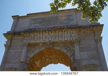 The Triumphal Arch of Titus (Arco di Tito) is a 1st-century honorific arch located on the Via Sacra just to the south-east of the Roman Forum Rome.