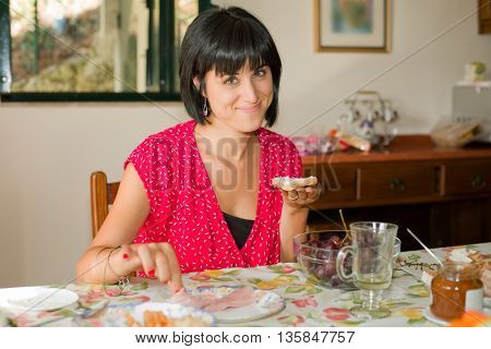 Young woman taking a breakfast at home