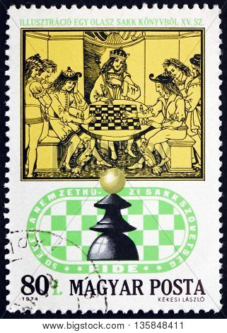 HUNGARY - CIRCA 1974: a stamp printed in Hungary shows Royal Chess Party 15th Century Italian Chess Book circa 1974