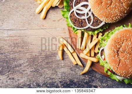Delicious burgers with beef tomato cheese and salad