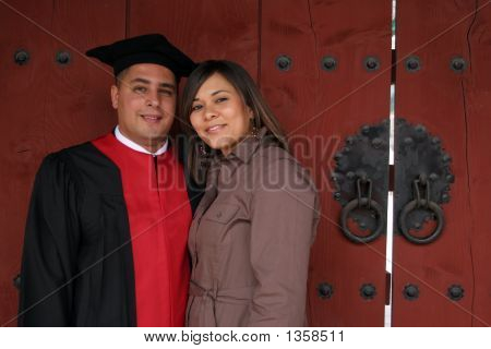 Graduate And His Wife On Ceremony Day.