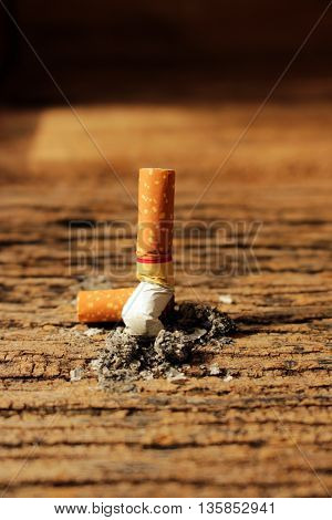 cigarettes consumed cigarette on old table texture