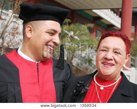 Happy Graduate Shares A Moment With His Grandmother