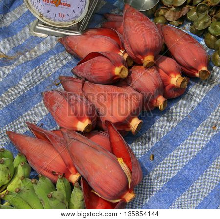 banana flower buds for sale at sidewalk market, Songkhla, Thailand