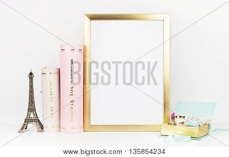 gold picture frame with decorations. Mock up for your photo or text Place your work, print art,shabby style, white background,, pastel color book, paris, lipstick, mint and gold accessories