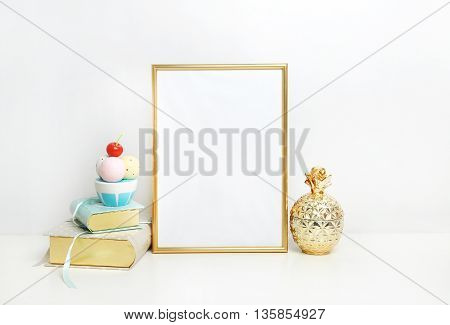 Frame mockup. Place your work. Golden pineapple and book with ice cream. Template print art, shabby style, white background.