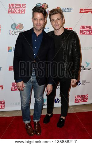 NEW YORK, NY-JUNE 3: Interior designer Nate Berkus (L) and husband Jeremiah Brent attend the 2015 Up2Us Sports Gala at IAC Building on June 3, 2015 in New York City.