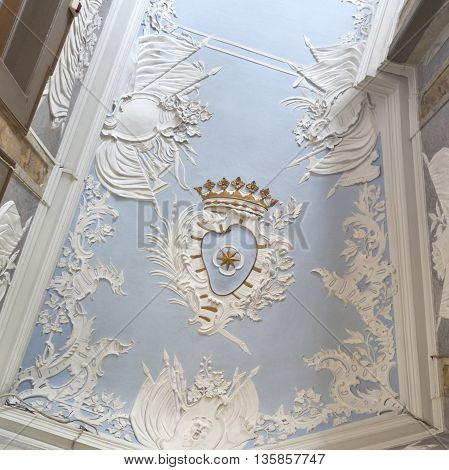 OEIRAS, PORTUGAL - November 4, 2015: Detail of a magnificent rococo stucco ceiling of the Concordia Room in he Palace of Oeiras on November 4, 2015 in Oeiras, Portugal